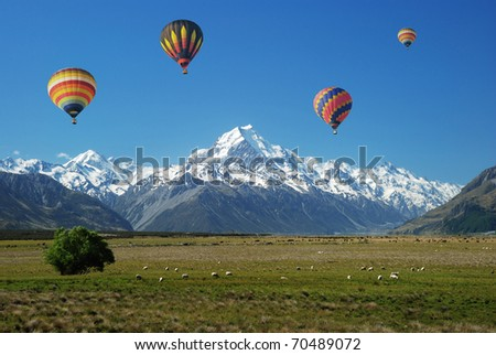 Colorful balloons floating over Mt. Cook - stock photo