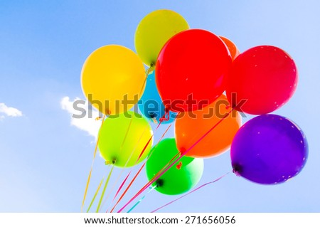 Colorful balloons flying in the sky - stock photo