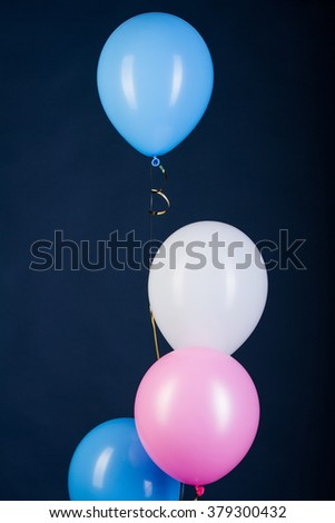 colorful balloons in a bunch: white, pink and blue - stock photo