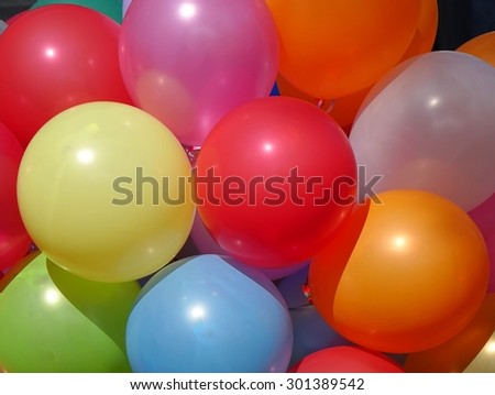 Colorful Balloons in bright colors create a happy atmosphere  - stock photo