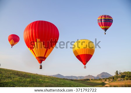 Colorful balloons in the sky - stock photo