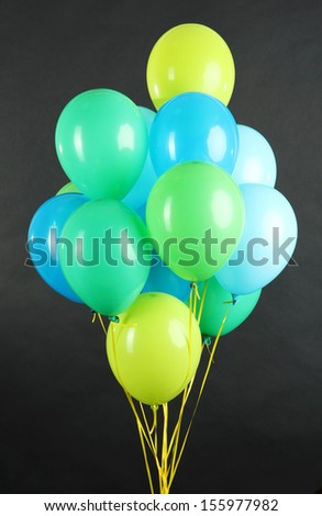Colorful balloons isolated on black - stock photo
