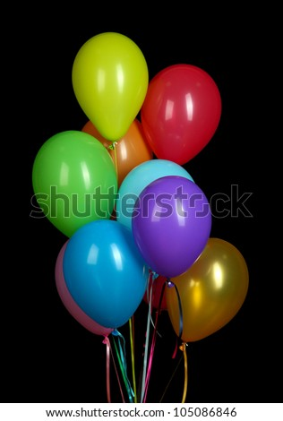 colorful balloons on black background close-up