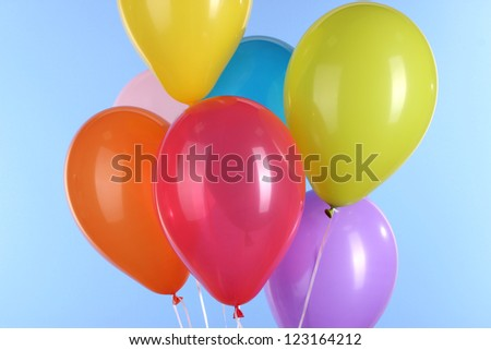 colorful balloons on blue background - stock photo