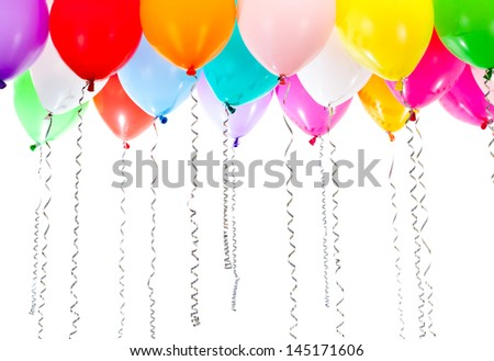 colorful balloons with streamers on birthday party - stock photo