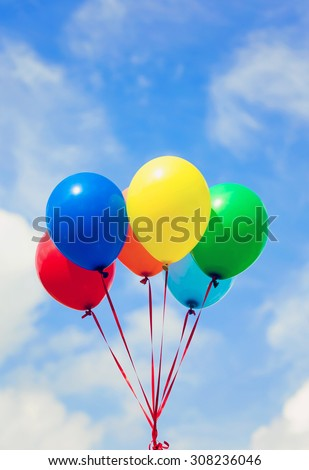 Colorful balloons with sunshine - stock photo