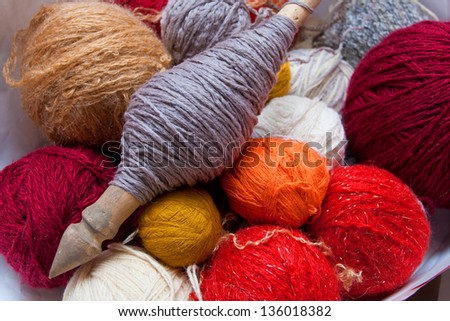 Colorful balls of wool for knitting the spinning wheel - stock photo