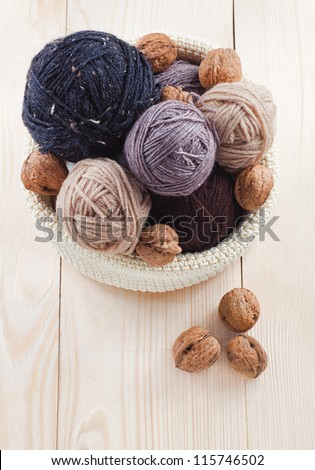 colorful balls of yarn on a wooden table - stock photo