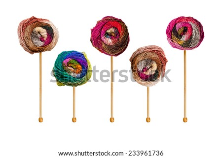 Colorful balls of yarn on knitting needles - stock photo