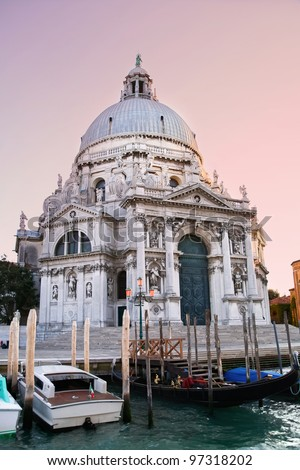 Colorful Basilica di Santa Maria della Salute with gondolas in Venice, Italy - stock photo