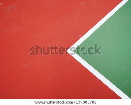 colorful basketball lines on an outdoor court - stock photo
