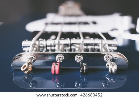colorful bass guitar strings installed on bridge, shallow dept of field. for music background - stock photo