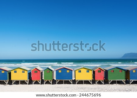 Colorful bathhouses at Muizenberg, Cape Town, South Africa, standing in a row. - stock photo