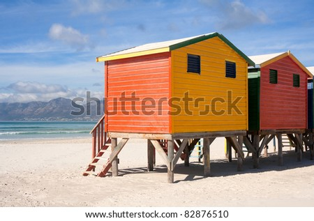 Colorful beach cabins in Muizenberg beach in South Africa - stock photo