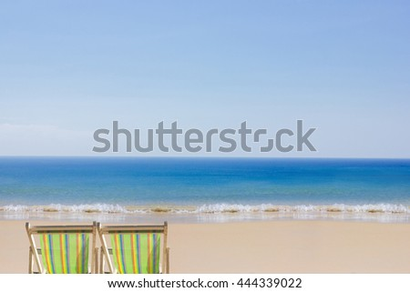 colorful beach chairs at blue sea white clean sand with blue clear sky line : nature, vacation concept