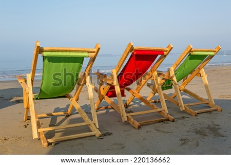 colorful beach chairs on the seaside - stock photo