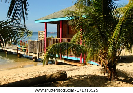 Colorful beach hut, Roatan, Honduras.  - stock photo