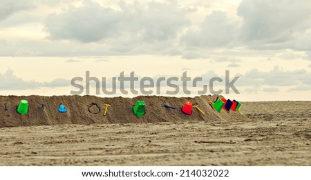 colorful beach items on sand near the sea. South Beach in Miami. - stock photo