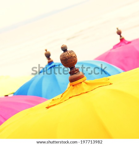 Colorful Beach Umbrella against the Sky. Shallow depth of field . (retro effect) - stock photo
