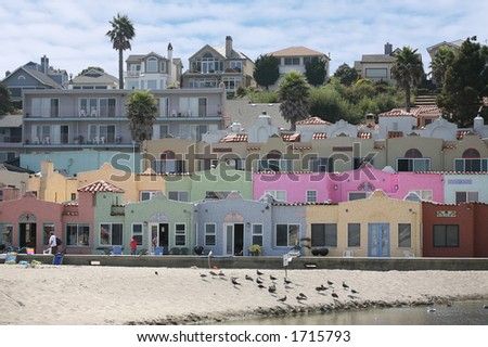 Colorful beachfront property under a cloudy sky - stock photo