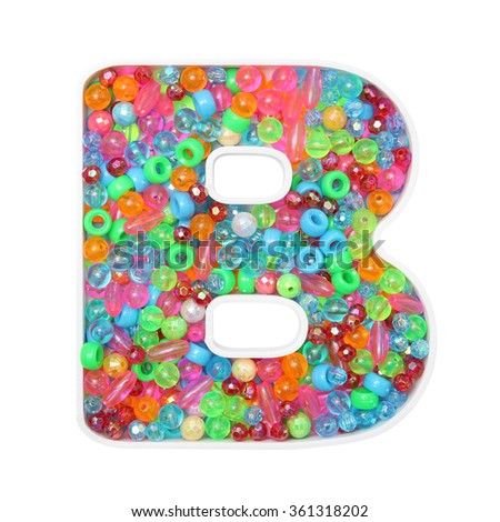 Colorful beads on alphabet plate
