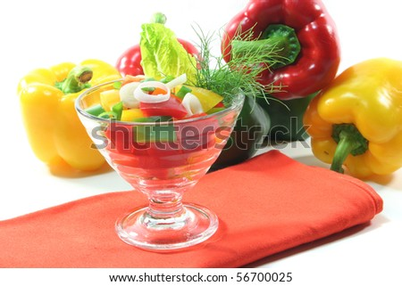 colorful bell pepper salad with dill in a small glass bowl - stock photo