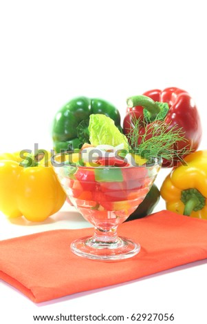 colorful bell pepper salad with dill in small glass bowls - stock photo
