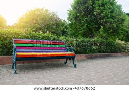 Colorful Bench in the park sunlight in the morning - stock photo