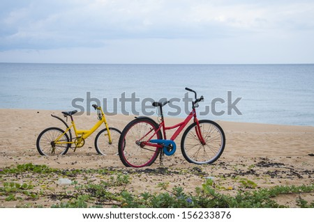 Colorful bicycles parked at the beach. - stock photo