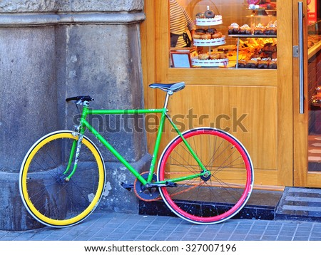 Colorful bike in the street - stock photo