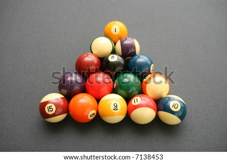 Colorful Billiard Balls on a Pool Table with gray felt - stock photo