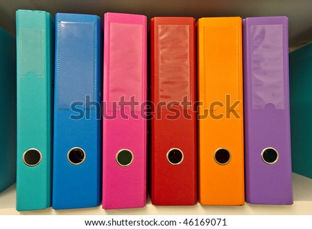 Colorful binders on the shelf