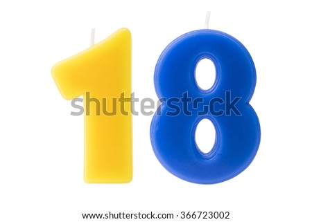 Colorful birthday candles in the form of the number eighteen on white background