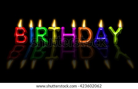 Colorful birthday candles on black background