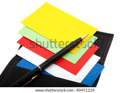 Colorful blank business cards spread out in leather card holder, with pen. - stock photo