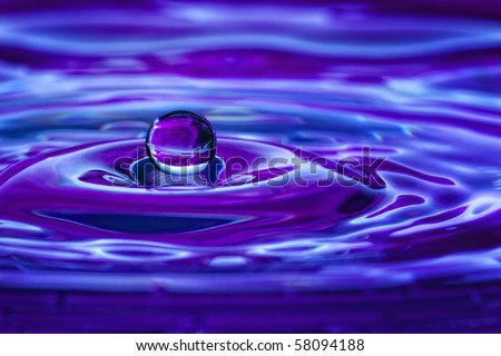 Colorful blue and purple water drop and splash - stock photo