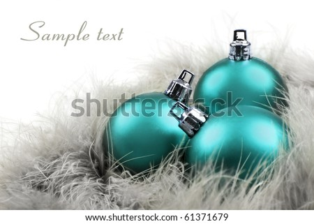 Colorful blue christmas ornaments on a white background with space for text - stock photo