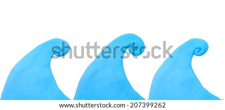 Colorful blue wave plasticine clay on white background - stock photo