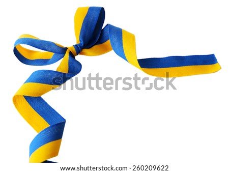 Colorful blue-yellow fabric ribbon with bow isolated on white - stock photo