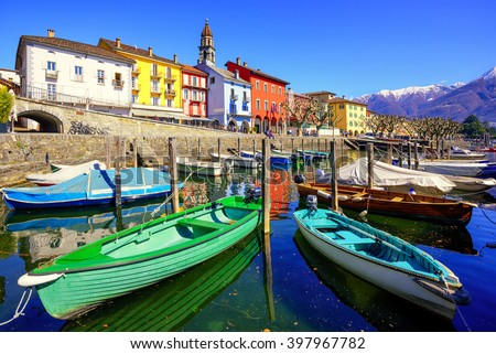 Colorful boats in old town of Ascona on Lago Maggiore lake in the Alps mountain, Ticino, Switzerland - stock photo