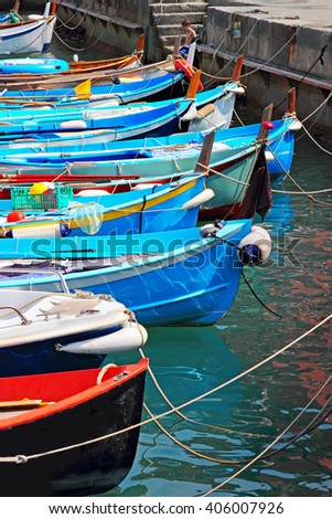Colorful boats in sea port, Vernazza, Cinque Terre, Italy. - stock photo