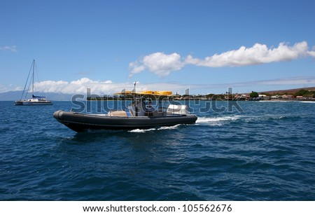 Colorful Boats on Pacific Ocean Maui Hawaii - stock photo