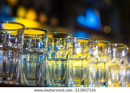 colorful bokeh behind the glasses with narrow depth of field selective focus - stock photo