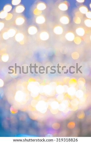 Colorful Bokeh light Background with multi layers . Golden Holiday Abstract Glitter Defocused Background With Blinking Stars. Blurred Bokeh  - stock photo