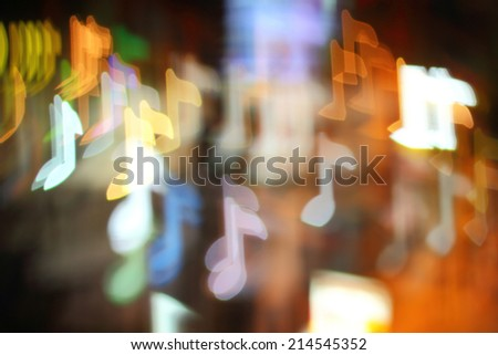 Colorful bokeh musical notes shape ,the art from night lights - stock photo
