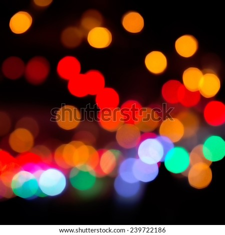 Colorful bokeh on a dark background. Defocused bokeh lignts. Abstract Christmas batskground. Abstract circular bokeh background of Christmaslight - stock photo
