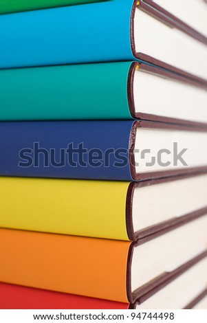 Colorful books on pile. - stock photo