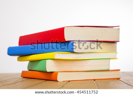 Colorful books on wooden table