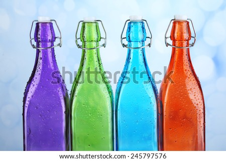 Colorful bottles on light background