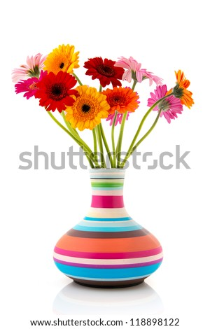 Colorful bouquet Gerber flowers in modern striped vase - stock photo